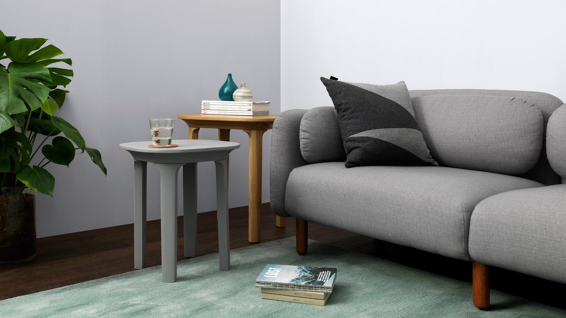 用高低两款瓦檐边桌组合,高度差设计带来错落有致的感受,让冷色调鹅卵石沙发变得灵动起来。