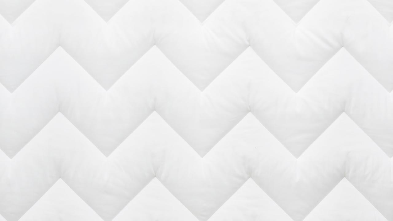 折线形绗缝图案,不易移位
