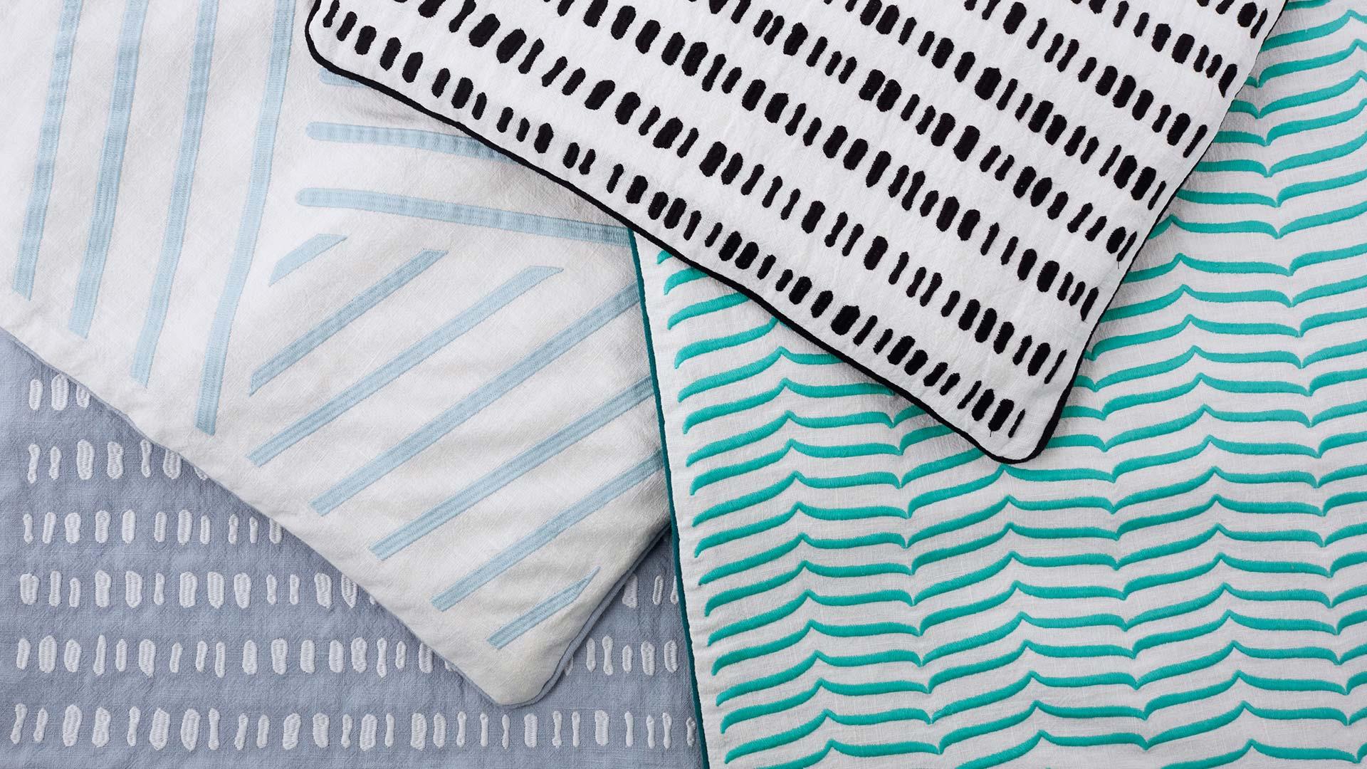 细语抱枕包括3种系列,春分、立夏、谷雨,以颜色图样将节气设计表达,再以近10万针刺绣立体展现。?x-oss-process=image/format,jpg/interlace,1