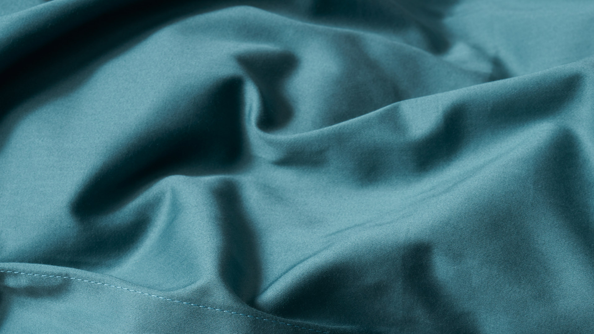 甄选精梳棉,编织如彩锦绣
